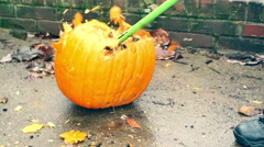 Smashing a pumpkin sledge hammer break Stock Footage