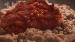 Adding vegetable sauce to roasting meat stuffing. Close up video Stock Footage