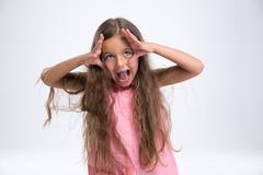 Portrait of a little girl having fun Stock Photos