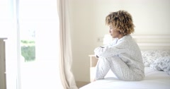 Sad Woman Sitting On The Bed Stock Footage
