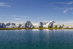Schafkogelsee lake with paragliders Hutterer Hoss Totes Gebirge Upper Austria - stock photo