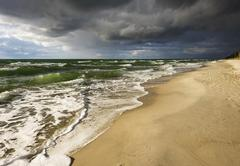 Stock Photo of Dark rain clouds over Weststrand Beach Baltic Sea Born auf dem Darss