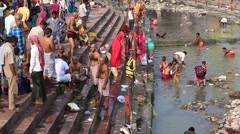 Indian people at ritual washing in Ganges river. Haridwar, India Stock Footage