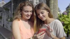 Teens Look At Photos On Smart Phone, Then Take A Selfie Together, On Nantucket Stock Footage