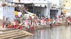 Indian people at ritual washing in sacred lake. Pushkar, India Stock Footage