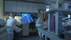Group of caucasian scientists in white coats are working in a modern laboratory Stock Footage