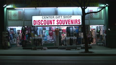 Discount Souvenirs Storefront at Night Stock Footage