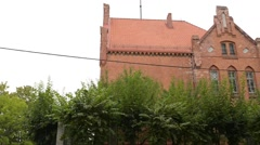 Old gymnasium in Barczewo, Poland - stock footage