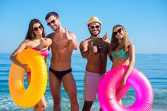 Young people having fun on the beach. - stock photo