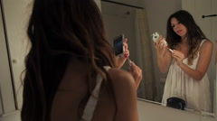 Woman Using Smart Phone getting ready for work in the morning Stock Footage