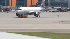 Stock Video Footage of Big traffic of passengers airliners and service cars ride at airdrome