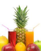 Glass with juice and fruits Stock Photos