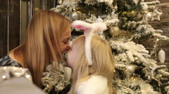 Mother and daughter touching each other nose to nose. Stock Footage