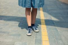 Legs of woman tanding in the street Stock Photos