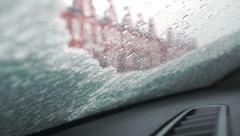 Snow thawing on a windshield of a car. Timelapse video - stock footage