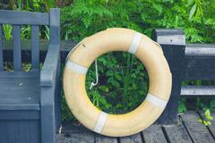 Life buoy in forest - stock photo