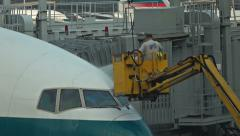 Airport attendant washing airplane in airport Hong Kong city. - stock footage