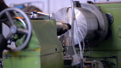 A milling machine operator working factory workshop makes some particular on - stock footage
