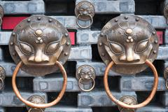 Chinese knockers on a wall - stock photo
