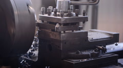 A milling machine cuts the workpiece with layers of metal shavings. Work Stock Footage