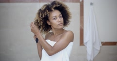 Woman Fixing Hair In The Morning Stock Footage