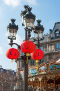 Chinese lanterns hanging on lampost in Paris - stock photo
