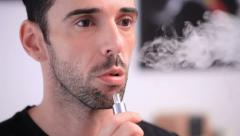 Man smoking an e-cigarette Stock Footage