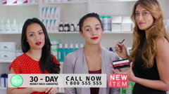 4K TV presenters on shopping channel selling beauty products & talking to camera - stock footage