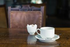 Cup of tea on table in dining room Stock Photos