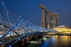 Singapore Marina Bay Helix Bridge Skyline city at night Stock Photos