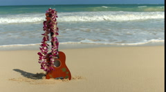 Hawaii Concept With Ukulele And Lei On Beach - stock footage