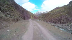 Car driving on winding mountain road,Qinghai,China. Stock Footage
