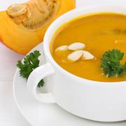 Pumpkin soup closeup with pumpkins healthy eating Stock Photos