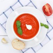 Tomato soup meal with tomatoes in bowl from above healthy eating - stock photo
