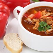 Goulash soup with meat and paprika in cup closeup healthy eating Stock Photos