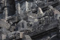 Stoned image of Buddha in Borobudur, Indonesia Stock Photos
