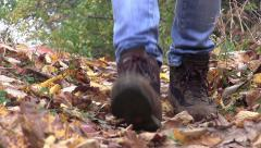 Tourist boots walking the path covered by leaves 72 Stock Footage