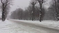 Vehicles traveling on a road that isn't cleaned of snow 73 - stock footage