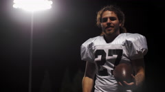 Portrait of a football player holding a football Stock Footage