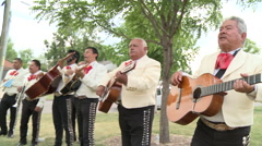 Mariachi band performing outside Stock Footage