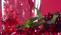 Garnet. Pomegranate juice is poured into a glass. Slow motion 240 fps. - stock footage