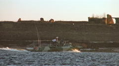 Watch military Russian boat sailing on the lake Ladoga past fortress Oreshek. Stock Footage