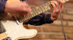 Performer guy play electro guitar on a stage Stock Footage