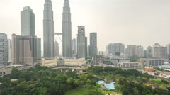 Time lapse footage of cloudy hazy day to night at Kuala Lumpur City Stock Footage