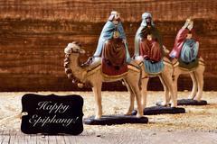 Three kings and text happy epiphany Stock Photos
