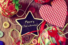 Star-shaped chalkboard with the text merry christmas Stock Photos