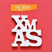 Stock Photo of text merry christmas on a colorful background