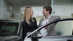 Young couple rejoicing buying a car - stock footage
