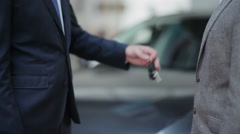 Handing over the keys and handshake Stock Footage