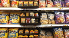Tostitos chips in grocery store aisle Stock Footage